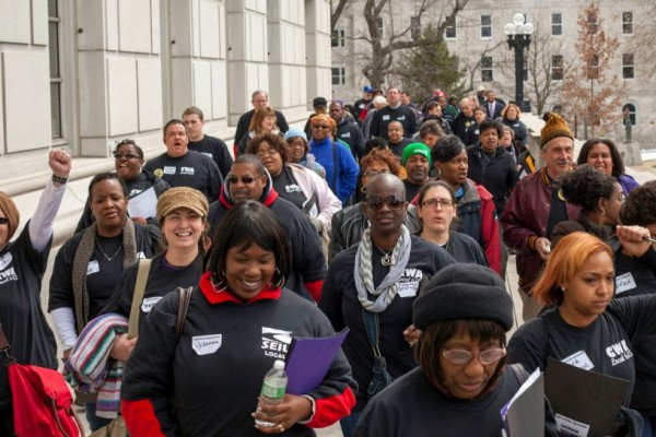 CWA Local 6355, SEIU 1, and AFSCME Council 72 march to rally outside the capital
